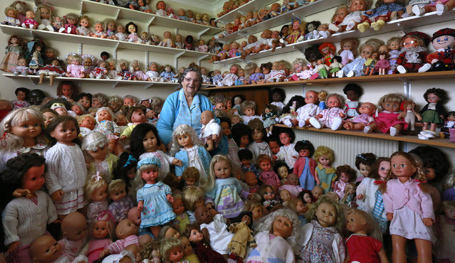 Mary Hickey poses with her collection of dolls at her home in Ashbourne, Ireland October 9, 2013. Hickey has been collecting the dolls for over thirty years and now owns over 420 dolls. (Photo by Cathal McNaughton/Reuters)