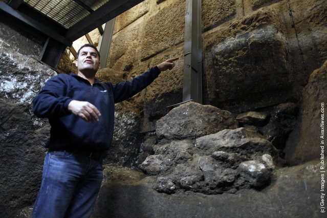 Israeli Archaeologist Eli Shukron of the Israel Antiquities Authority speaks inside a ritual bath exposed beneath the Western Wall in Jerusalem's Old City, Israel