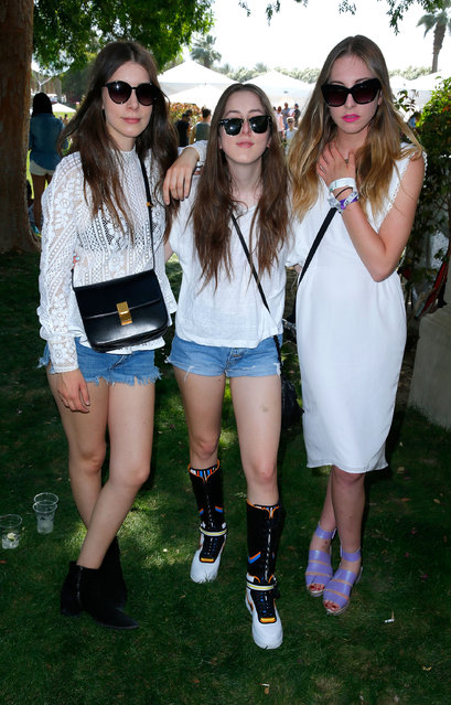 (L-R) Musicians Alana Haim, Danielle Haim and Este Haim attend Day 1 of the LACOSTE Beautiful Desert Pool Party on April 12, 2014 in Thermal, California.  (Photo by Joe Scarnici/Getty Images for LACOSTE)