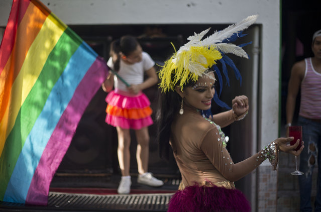 A member of the LGBT movement takes part in the Gay Pride parade celebration in Managua, Nicaragua, Sunday, June 28, 2015. (Photo by Esteban Felix/AP Photo)
