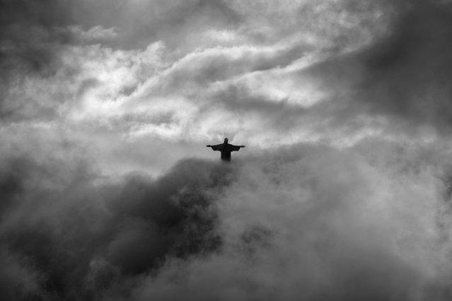 """""""A question of Faith"""". A different view of the Christ the Redeemer at the top of Corcovado, in Rio de Janeiro, appearing from a cloudy shroud. Photo location: Rio de Janeiro, Brazil. (Photo and caption by Pedro Moura Pinheiro/National Geographic Photo Contest)"""