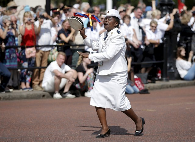 "A Salvation Army member from the Democratic Republic of Congo dances as she joins thousands of members of The Salvation Army from around the world, during a march down The Mall in London, Britain, July 5, 2015. The ""March of Witness"" marks the end of a week long event in London called Boundless, which included the official 150 year anniversary celebrations (July 2) since the church and charity was founded. (Photo by Peter Nicholls/Reuters)"