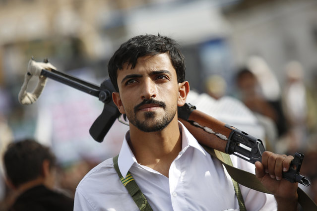 A Shiite rebel known as a Houthi attends a rally to mark Al-Quds (Jerusalem) day, in Sanaa, Yemen, Friday, July 10, 2015. (Photo by Hani Mohammed/AP Photo)