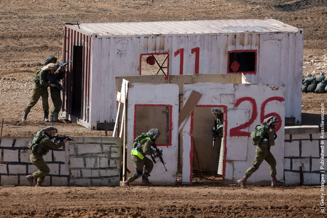 Israeli soldiers take part in an army exercise on at the Shizafon army base, in the Negev Desert north of the southern city of Eilat