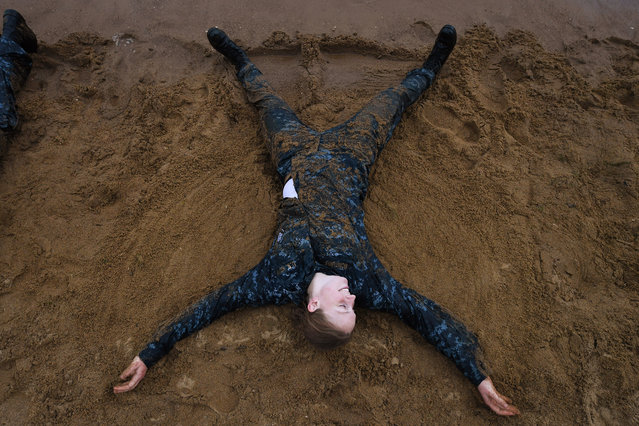 """United States Naval Academy plebe, Katey McInturff takes part in the """"Wet and Sandy"""" portion of Sea Trials at the United States Naval Academy on Tuesday May 17, 2016 in Annapolis, MD. (Photo by Matt McClain/The Washington Post)"""