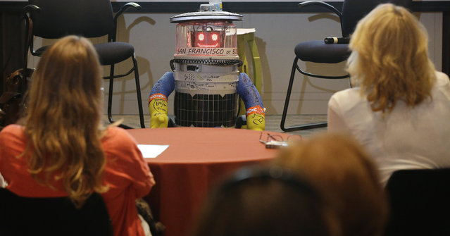 HitchBOT, a hitchhiking robot, is formally introduced to an American audience, during a program at the Peabody Essex Museum Thursday, July 16, 2015, in Salem, Mass. HitchBOT is set to embark on its' first cross-country hitchhiking trip of the U.S., after completing similar tips in Canada and Europe. The plans are for hitchBot to leave the Boston area Friday with a final destination goal of reaching San Francisco. (Photo by Stephan Savoia/AP Photo)
