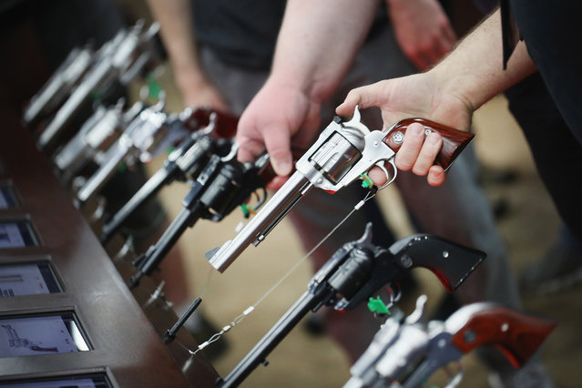 Gun enthusiasts look over Ruger pistols at the NRA Annual Meetings & Exhibits on May 21, 2016 in Louisville, Kentucky. (Photo by Scott Olson/Getty Images)