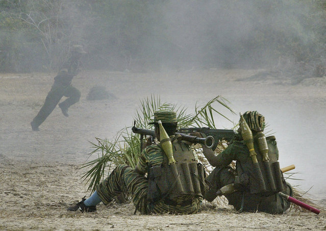 In this  July 13, 2007, file photo, Tamil Tiger fighters take part in a training of breaking through outer defense lines of a military camp, in an undisclosed location deep in Tiger controlled territory, northeast of Colombo, Sri Lanka. The April 21, 2019 deadly Easter attacks in Sri Lanka are a bloody echo of decades past in the South Asian island nation, when militants inspired by attacks in the Lebanese civil war helped develop the suicide bomb vest. Over nearly 30 years of civil war, the Tamil Tigers would launch more than 130 suicide bomb attacks, making them the leading militant group in such assaults at the time. (Photo by Gemunu Amarasinghe/AP Photo/File)