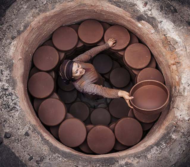 """""""O"""". In Turkey, they seem well in mud Karacasu are doing cooking cap. They earn money. The most important here laboring women in the workforce. Photo location: Turkey. (Photo and caption by Murat Yılmaz/National Geographic Photo Contest)"""