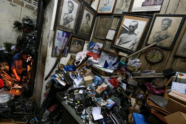 Portraits of Thailand's King Bhumibol Adulyadej hang on a wall at a mechanical workshop in Bangkok, Thailand, June 6, 2016. (Photo by Jorge Silva/Reuters)