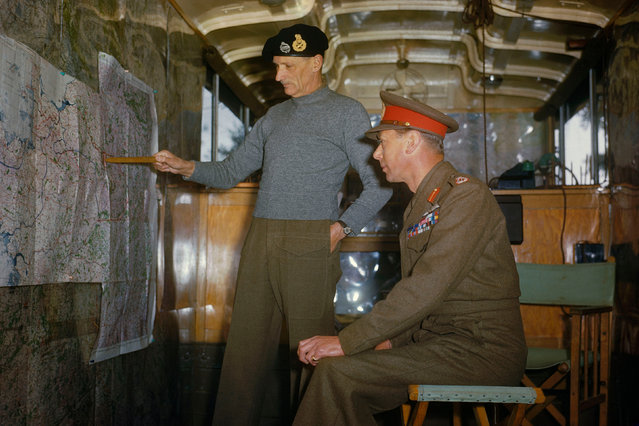 Field Marshal Sir Bernard Montgomery explaining Allied strategy to King George VI in his command caravan in Holland, October 1944. (Photo by Ted Dearberg/IWM/PA Wire)
