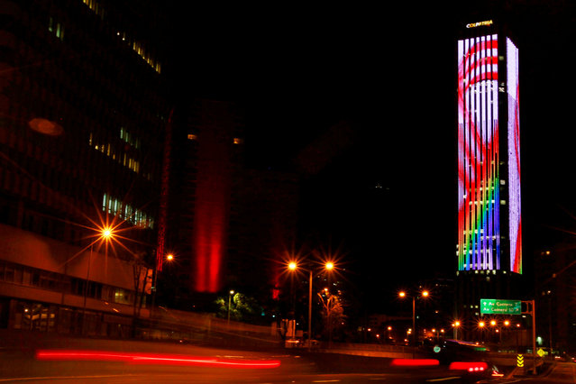 The Colpatria tower is lit in rainbow colors to honor the victims of the Orlando shooting massacre at the Pulse nightclub, in Bogota, Colombia June 14, 2016. (Photo by John Vizcaino/Reuters)