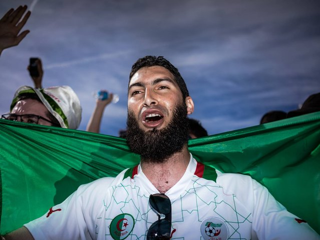 Brazil: Algerian fan supports his team during the Algeria v Belgium match. (Photo by Zackary Canepari)