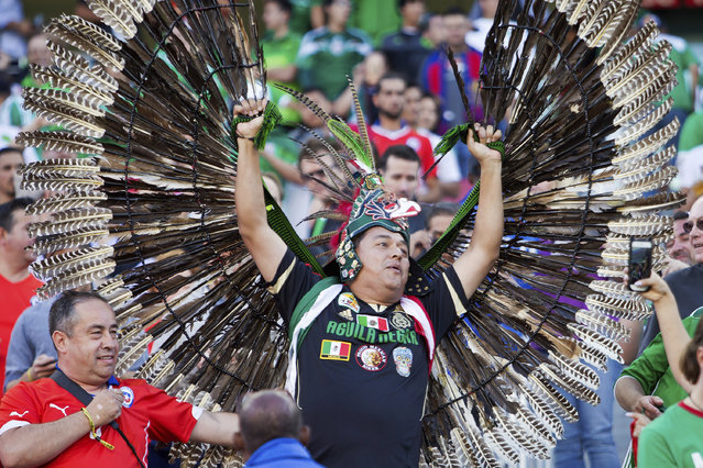 A Chilean fan and a Mexican fan cheer before a Quarterfinal match between Mexico and Chile at Levi's Stadium as part of Copa America Centenario US 2016 on June 18, 2016 in Santa Clara, California, US.  Chile won 7-0. (Photo by Brian Bahr/LatinContent/Getty Images)