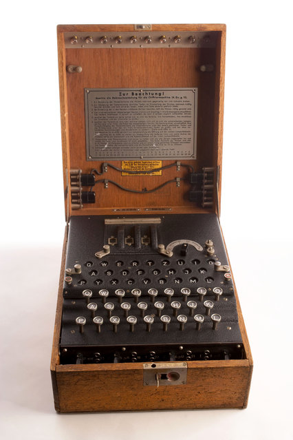 During World War II, the Germans used the Enigma, a cipher machine, to develop nearly unbreakable codes for sending messages. The Enigma's settings offered 150,000,000,000,000,000,000 possible solutions, yet the Allies were eventually able to crack its code. By end of the war, 10 percent of all German Enigma communications were decoded at Bletchley Park, in England, on the world's first electromagnetic computers. (Photo by Central Intelligence Agency)