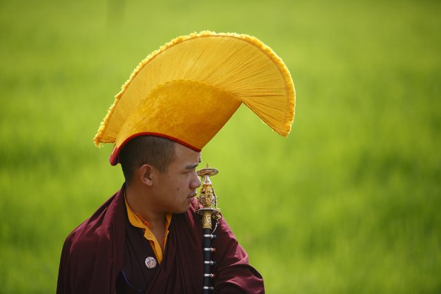 A Buddhist monk takes part in the funeral of Shamar Rinpoche in a monastery in Kathmandu July 31, 2014. Nepal has allowed a monk prominent in Tibetan Buddhism to be cremated in a monastery in Kathmandu, a minister said on Tuesday, disregarding fears of possible anti-China protests by his followers during the funeral. (Photo by Navesh Chitrakar/Reuters)