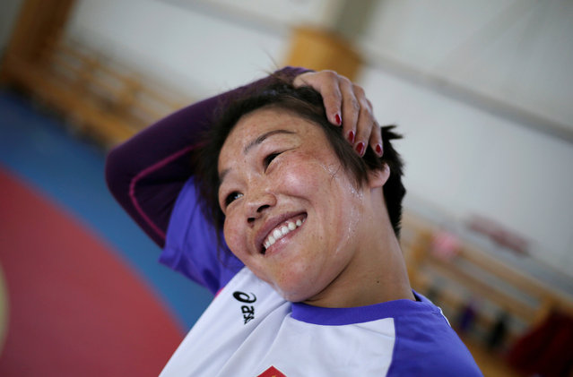 Mongolia's wrestler Sumiya Erdenechimeg stretches her neck ahead of a daily training session at the Mongolia Women's National Wrestling Team training centre in Bayanzurkh district of Ulaanbaatar, Mongolia, July 1, 2016. (Photo by Jason Lee/Reuters)