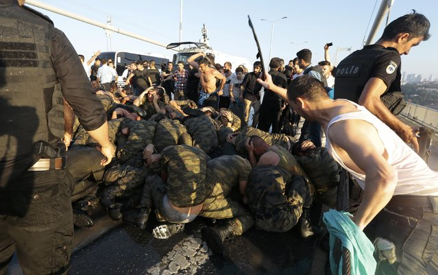 Surrendered Turkish soldiers who were involved in the coup are beaten by civilians on Bosphorus bridge in Istanbul, Turkey, July 16, 2016. (Photo by Reuters/Stringer)
