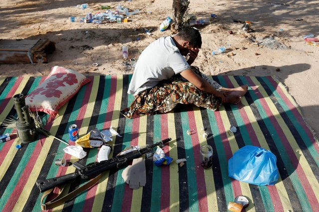 A member of the Libyan forces allied with the U.N.-backed government takes a break at the frontline in Sirte, Libya, July 18, 2016. (Photo by Goran Tomasevic/Reuters)