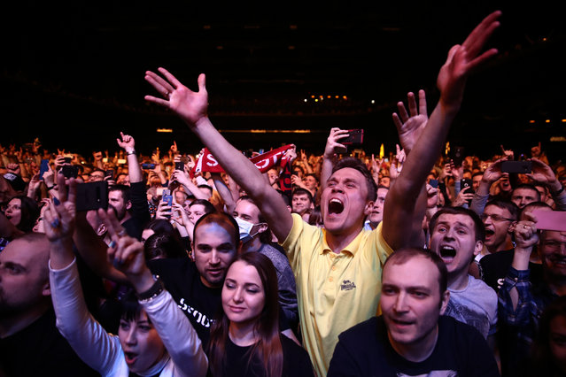 People attend a concert by the German rave and techno music band Scooter as part of the God Save The Rave Tour at the Adrenaline Stadium Club in Moscow, Russia on March 14, 2020. (Photo by Sergei Fadeichev/TASS)