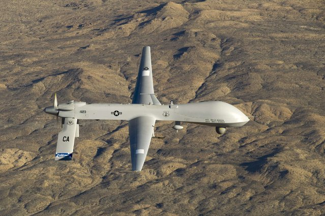 A U.S. Air Force MQ-1 Predator unmanned aerial vehicle assigned to the California Air National Guard's 163rd Reconnaissance Wing flies near the Southern California Logistics Airport in Victorville, California in this January 7, 2012 USAF handout photo obtained by Reuters February 6, 2013. The U.S. military has deployed two MQ-1 Predator reconnaissance drones and 70 airmen to Latvia on a training mission as part of U.S. efforts to reassure European allies the United States is committed to their security, the Pentagon said on August 31, 2015. (Photo by Tech. Sgt. Effrain Lopez/Reuters/U.S. Air Force)