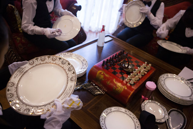 Butlery students polish china in preparation for a formal dinner at The International Butler Academy China on September 16, 2014 in Chengdu, China. (Photo by Taylor Weidman/Getty Images)