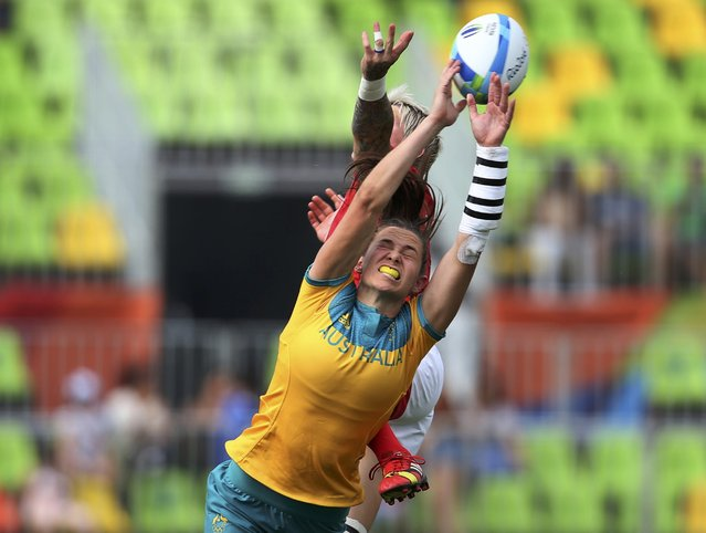 2016 Rio Olympics, Rugby, Women's Semifinals Australia vs Canada, Deodoro Stadium, Rio de Janeiro, Brazil on August 8, 2016. Charlotte Caslick (AUS) of Australia and Bianca Farella (CAN) of Canada fight for the ball. (Photo by Alessandro Bianchi/Reuters)