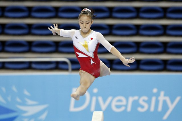 Japan's Sakura Yumoto competes on the beam event of the women's team final gymnastics competition at the Namdong Gymnasium Club during the 17th Asian Games in Incheon September 22, 2014. (Photo by Kim Hong-Ji/Reuters)