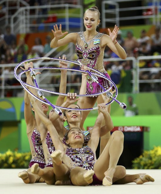 2016 Rio Olympics, Rhythmic Gymnastics, Preliminary, Group All-Around Qualification, Rotation 2, Rio Olympic Arena, Rio de Janeiro, Brazil on August 20, 2016. Team Uzbekistan (UZB) compete using clubs and hoops. (Photo by Mike Blake/Reuters)