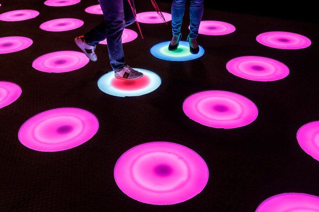 Visitor step on a LED art installation during a media preview of Arts and Lights at Icon City in Kuala Lumpur, Malaysia, 17 November 2017. Arts and Lights is the Malaysia's first interactive Pop-Up art and technology experience. (Photo by Ahmad Yusni/EPA/EFE)