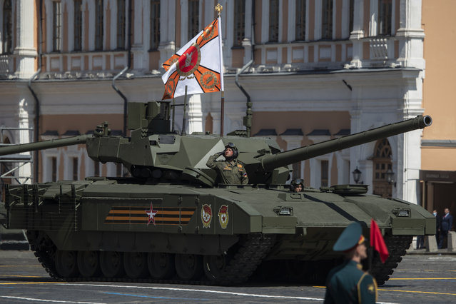 Russian army's Armata tank rolls through Red Square during the Victory Day military parade marking the 75th anniversary of the Nazi defeat in WWII, in Moscow, Russia, Wednesday, June 24, 2020. (Photo by Pavel Golovkin/AP Photo/Pool)