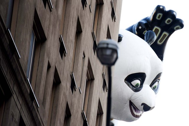 The Kung Fu Panda balloon floats in the Macy's Thanksgiving Day Parade in New York. (Photo by Charles Sykes/Associated Press)