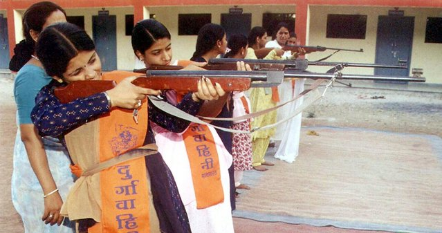 Girls from the Durga Vahini, the women's faction of the Vishwa Hindu Parishad or World Hindu Council, train in the use rifles in Bhopal, the capital of Madhya Pradesh, on May 19, 2001. (Photo by Sherwin Crasto/Reuters)