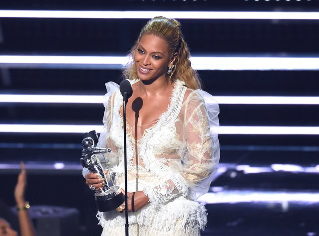 """Beyonce accepts the award for Video of the Year for """"Lemonade"""" at the MTV Video Music Awards at Madison Square Garden on Sunday, August 28, 2016, in New York. (Photo by Charles Sykes/Invision/AP Photo)"""