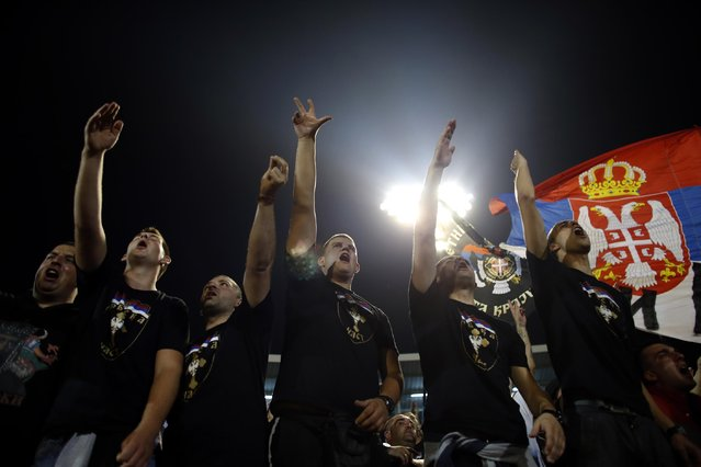 Serbian fans chant before the Euro 2016 Group I qualifying match between Serbia and Albania, at the Partizan stadium in Belgrade, Serbia, Tuesday, October 14, 2014. (Photo by Marko Drobnjakovic/AP Photo)