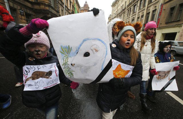 "Animal rights activists take part in an anti-fur march titled ""Animals are not clothes"" in St. Petersburg, Russia, October 19, 2014. Participants gathered to protest against the slaughtering of animals for the production of fur used in winter outfits and in the clothing industry, according to organizers. (Photo by Alexander Demianchuk/Reuters)"