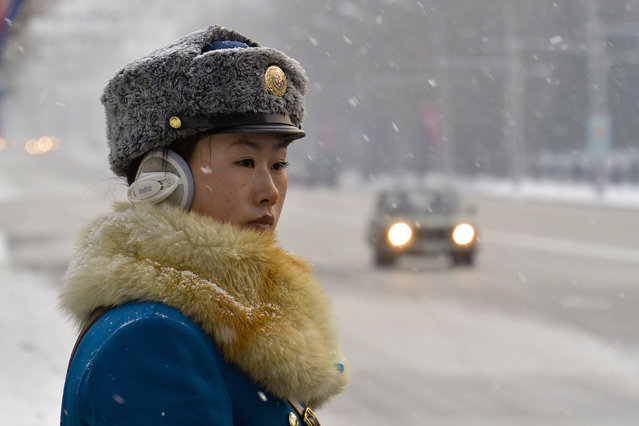 A female traffic police officer in the snow in February 2013, in Pyongyang, North Korea. (Photo by Andrew Macleod/Barcroft Media)
