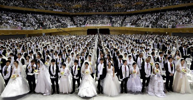 Couples from around the world participate in a mass wedding ceremony at the CheongShim Peace World Center in Gapyeong, South Korea.  (Photo by Lee Jin-man/Associated Press)