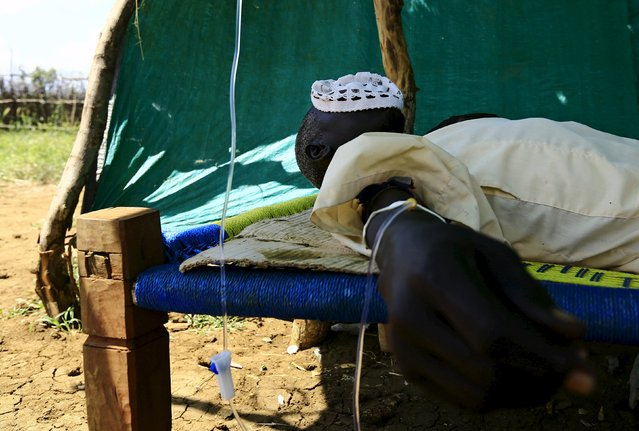 A man receives treatment during visit by a European Union delegation, at an IDP camp in Azaza, east of Ad Damazin, capital of Blue Nile state, October 21, 2015. (Photo by Mohamed Nureldin Abdallah/Reuters)