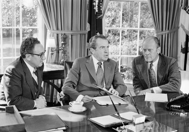 """In this October 13, 1973 file photo, then-vice presidential nominee Gerald R. Ford, right, listens as President Richard Nixon, accompanied by Secretary of State Henry Kissinger, speaks in the Oval Office of the White House in Washington. Overseas reaction to Nixon's resignation in 1974 was mixed: The Soviets expressed worry about the future of detente. North Korea reacted brashly, calling Nixon's exit the """"falling out"""" of the """"wicked boss"""" of American imperialists. South Vietnam put its forces on high alert because it feared the North Vietnamese would take advantage of the vulnerable U.S. political situation. (Photo by Harvey W. Georges/AP Photo)"""