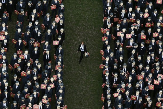 """Campaigners dressed as Britain's Chancellor of the Exchequer George Osborne congregate in Parliament Square in central London March 19, 2013. They were protesting on behalf of """"Enough Food for Everyone IF"""", a campaign to end global hunger. (Photo by Stefan Wermuth/Reuters)"""