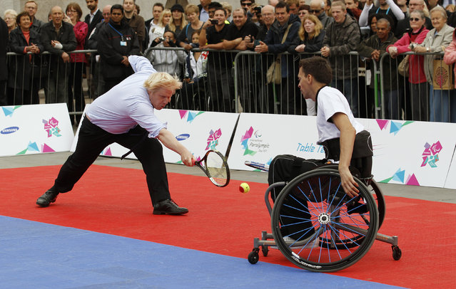 London Mayor Boris Johnson (L) plays a shot during a wheelchair tennis match with partner Adam Field, against Prime Minister David Cameron and John Parfitt, at an International Paralympic Day at Trafalgar Square in London September 8, 2011. (Photo by Suzanne Plunkett/Reuters)
