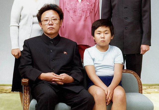 This file handout photo taken on August 19, 1981 and released to AFP in 2000 shows North Korean leader Kim Jong-Il (sitting-L) with his son, Kim Jong-Nam (sitting-R), for a family portrait in Pyongyang. The half-brother of North Korean leader Kim Jong-Un, who has been murdered in Malaysia, pleaded for his life after a failed assassination bid in 2012, lawmakers briefed by South Korea's spy chief said on February 15, 2017. Jong-Nam, the eldest son of the late former leader Kim Jong-Il, was once seen as heir apparent but fell out of favour following an embarrassing botched bid in 2001 to enter Japan on a forged passport and visit Disneyland. (Photo by AFP Photo/Stringer)
