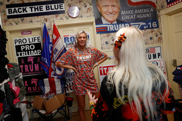 """Melanie Noftz, a volunteer and supporter of U.S. President Donald Trump, speaks with Diane Maxymczak, 64, at the self-proclaimed """"Trump House""""  in Youngstown, Pennsylvania, U.S., October 21, 2020. (Photo by Shannon Stapleton/Reuters)"""