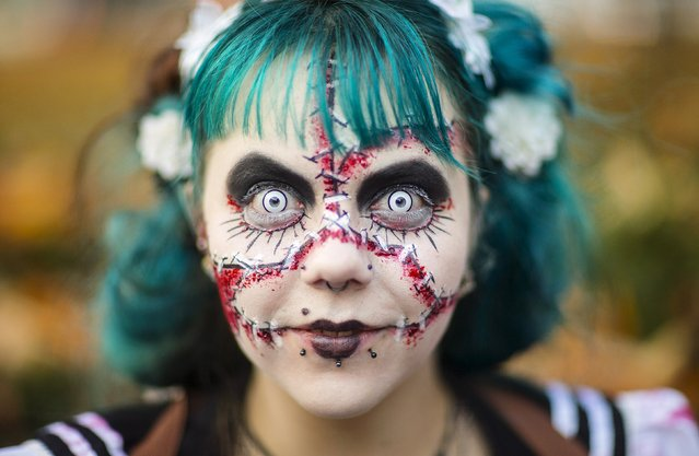 A woman takes part in a zombie walk during Halloween celebrations in Berlin, Germany, October 31, 2015. (Photo by Hannibal Hanschke/Reuters)