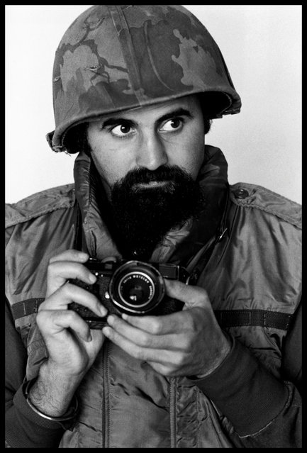 Vietnam, 1973. Abbas wears a helmet and flak-jacket while covering the war. (Photo by Magnum Photos)