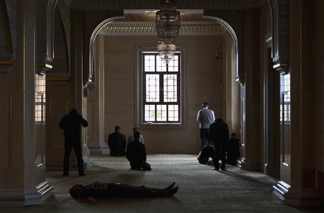 Muslim men wait for Friday prayers in the Heart of Chechnya Mosque in the Chechen capital Grozny April 26, 2013. (Photo by Maxim Shemetov/Reuters)