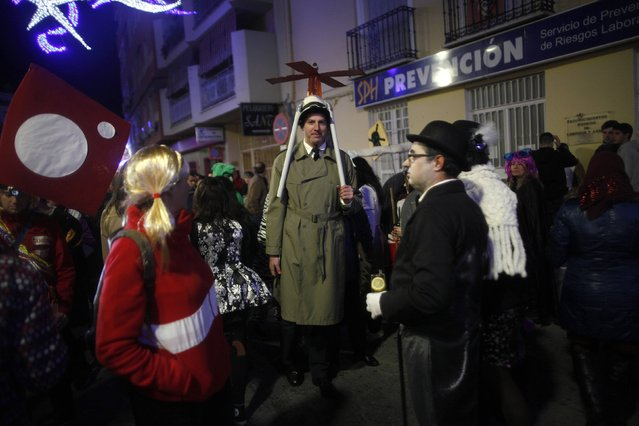 Revellers dressed up as the Inspector Gadget and his niece Penny (L), who is also known as Sophie in some countries in Europe, take part in New Year's celebrations in Coin, near Malaga, southern Spain, early January 1, 2015. (Photo by Jon Nazca/Reuters)