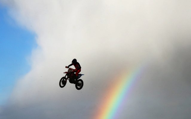 Richard Sikyna of Slovakia makes a jump as a rainbow forms behind in the MX2 race during the 2020 FIM MXGP World Championships on March 01, 2020 in Winchester, England. (Photo by Julian Finney/Getty Images)