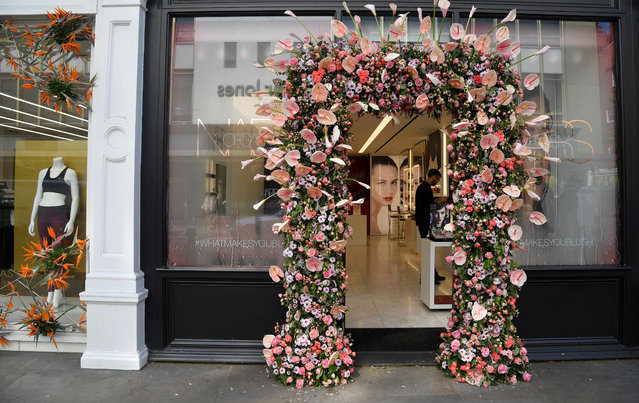 A floral display and design is seen outside of a shop front which is participating in the Chelsea In Bloom festival in London, Britain on May 22, 2018. (Photo by Toby Melville/Reuters)